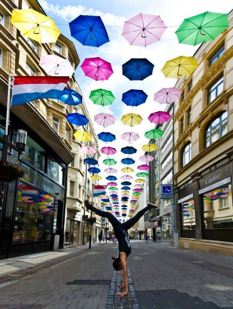 umbrellas handstand