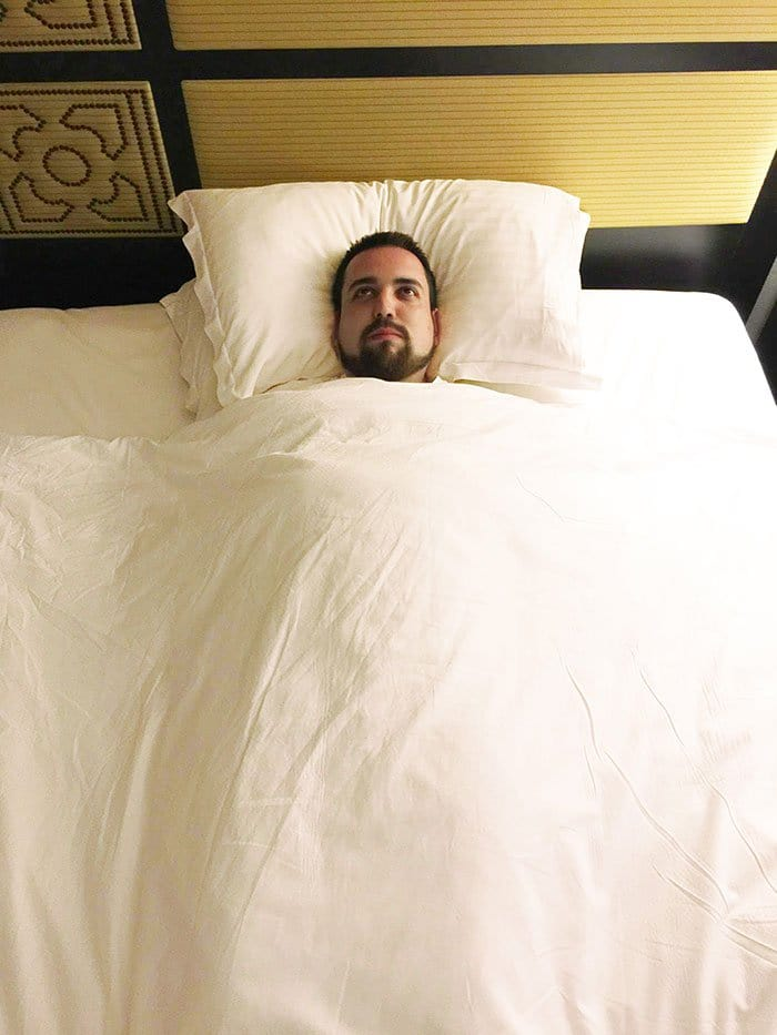 unhappy man bed alone