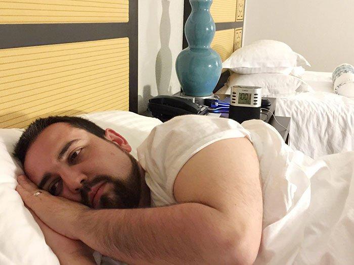 unhappy man bed