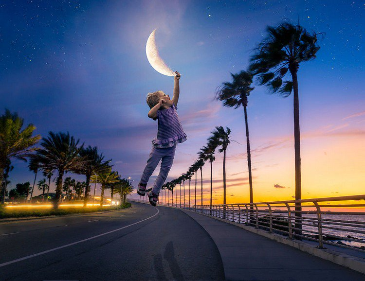 child catching moon