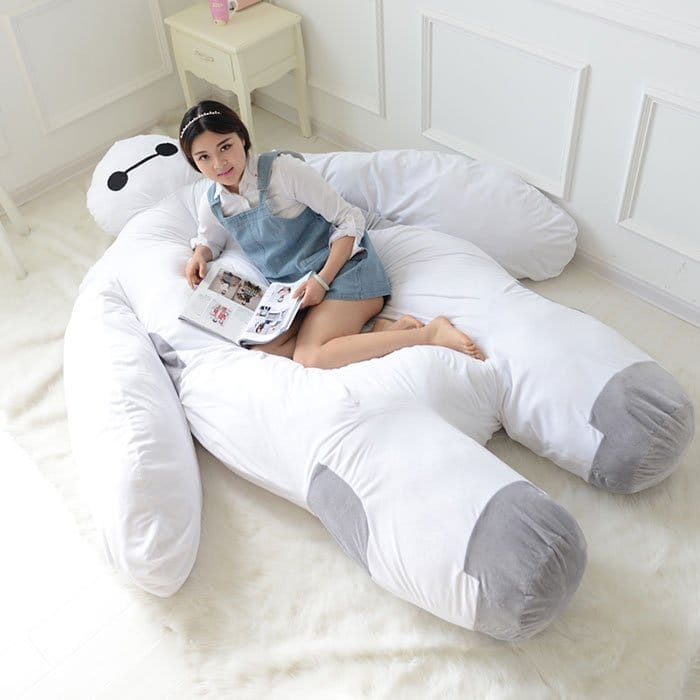 girl reading baymax bed