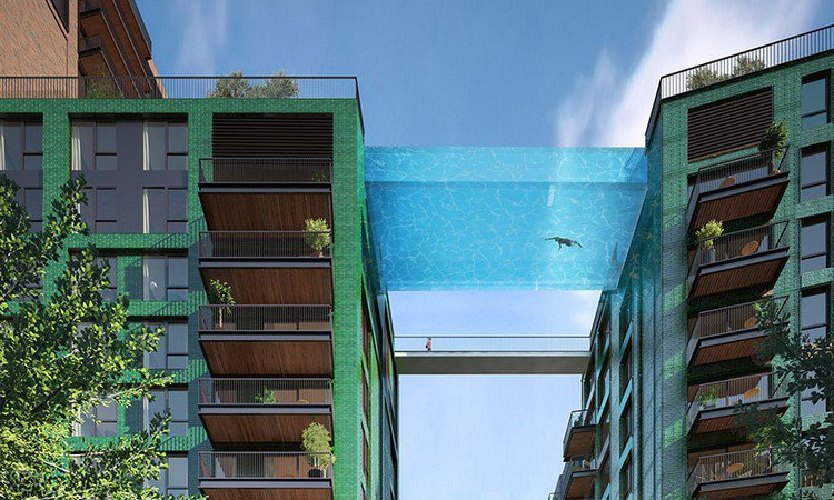 person swimming glass bottom pool