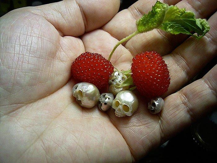 skull pearls berries hand