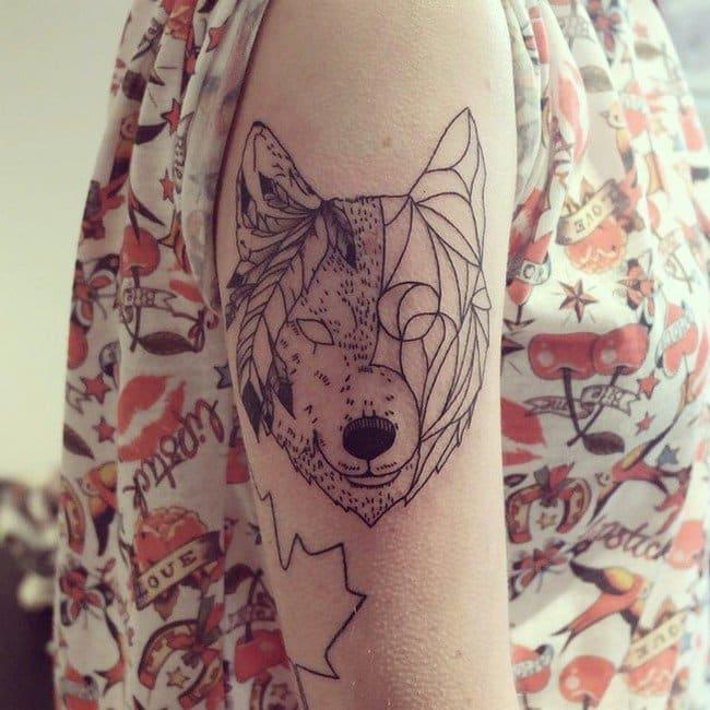 stylized wolf tattoo