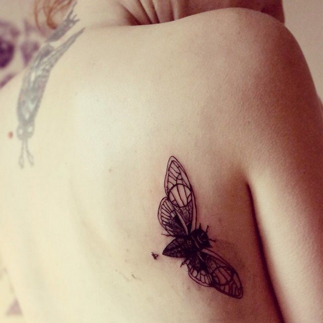winged insect tattoo