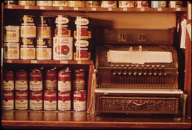 canned food next to a cash register