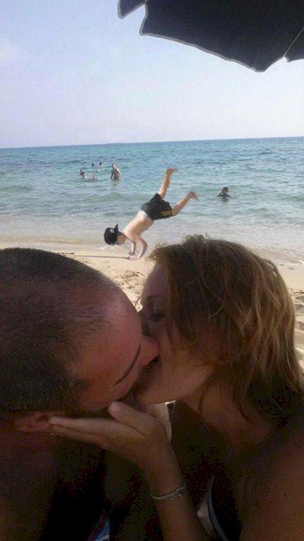 couple kissing boy falling