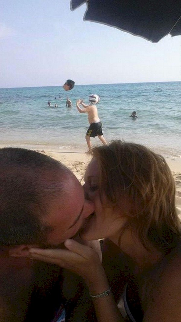 couple kissing boy head ball