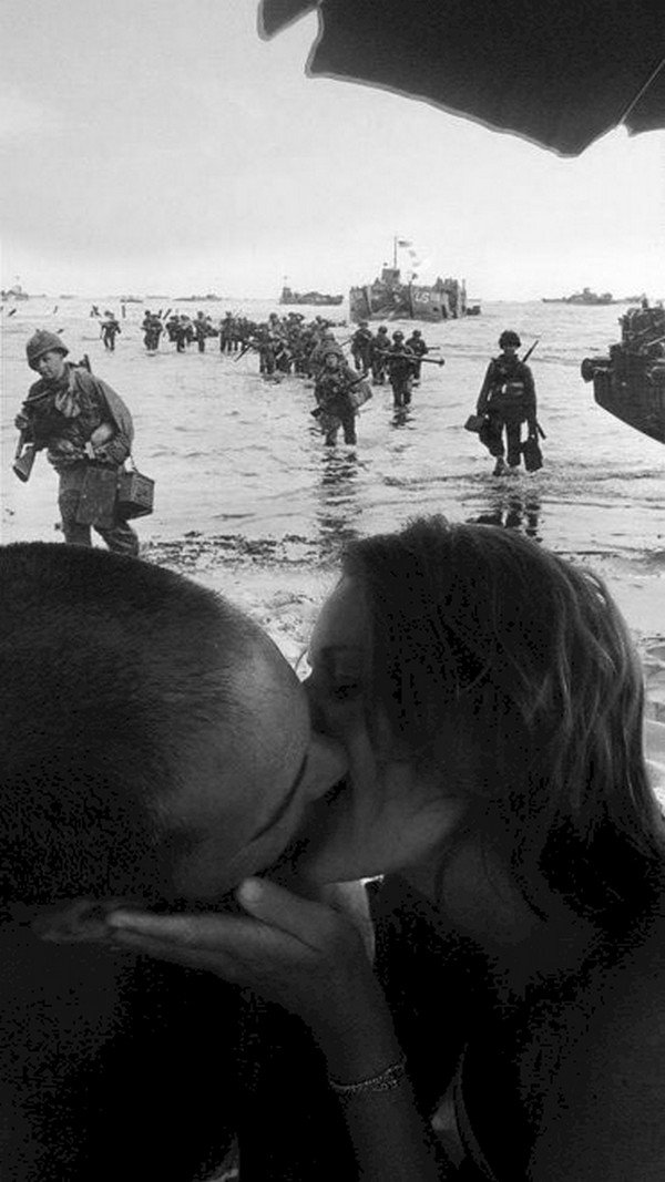 couple kissing troops landing