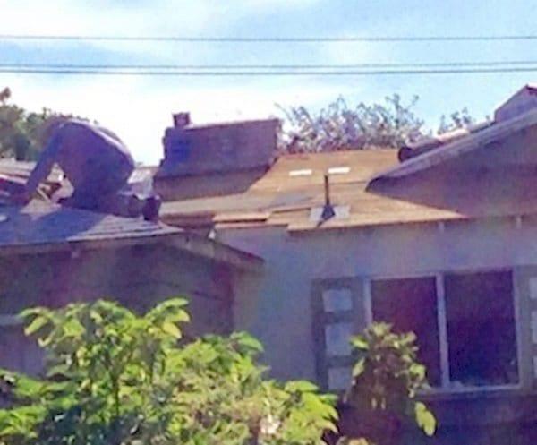 elderly man fixing roof