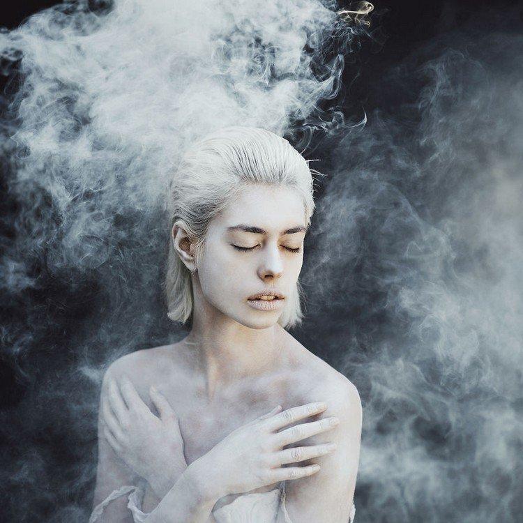 girl arms crossed smoke