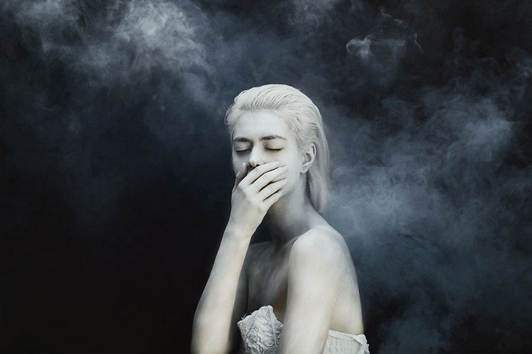 girl hand over mouth smoke
