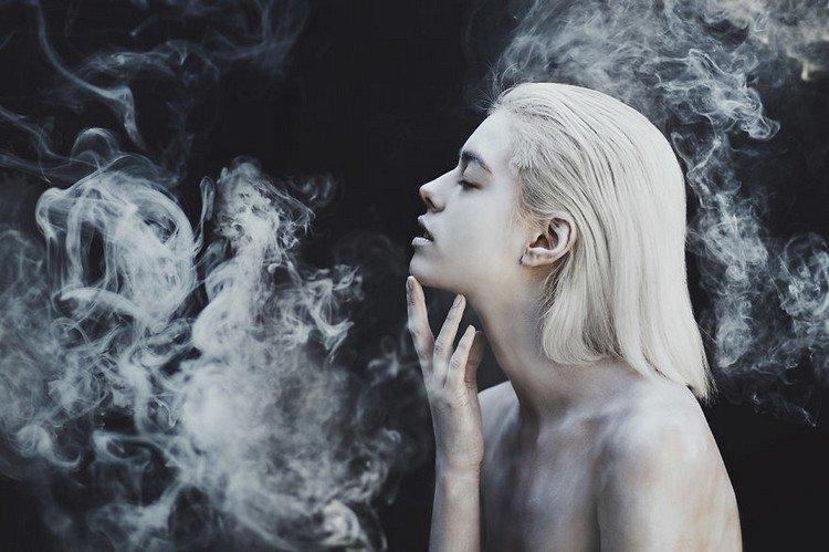 girl touch chin smoke