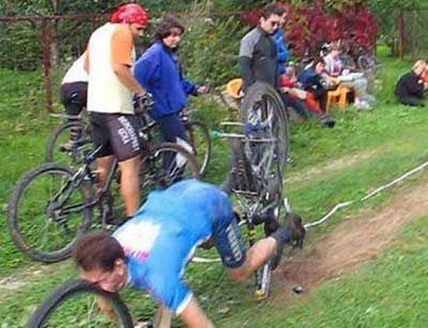 guy falling bike wheel