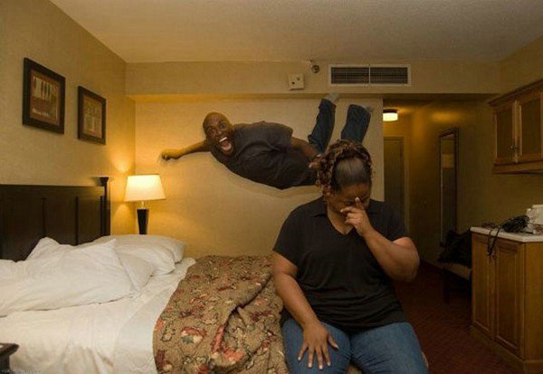 guy jumping hotel bed