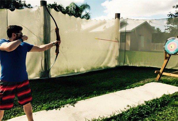 man arrow target