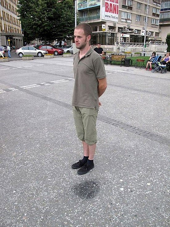 man floating in street illusion