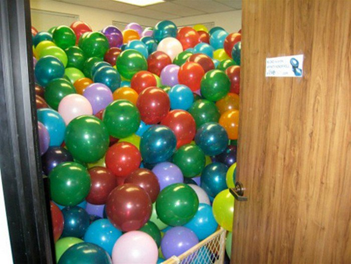 office filled with balloons
