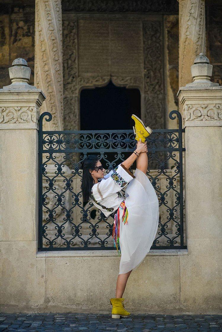 romanian ballerina holding leg