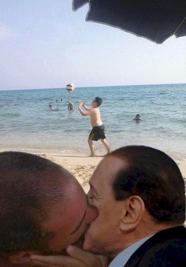 silvio berlusconi man kissing