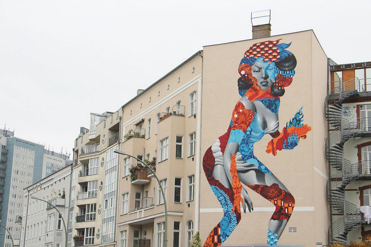 artist creates mural of 50 foot woman on the side of a. Black Bedroom Furniture Sets. Home Design Ideas
