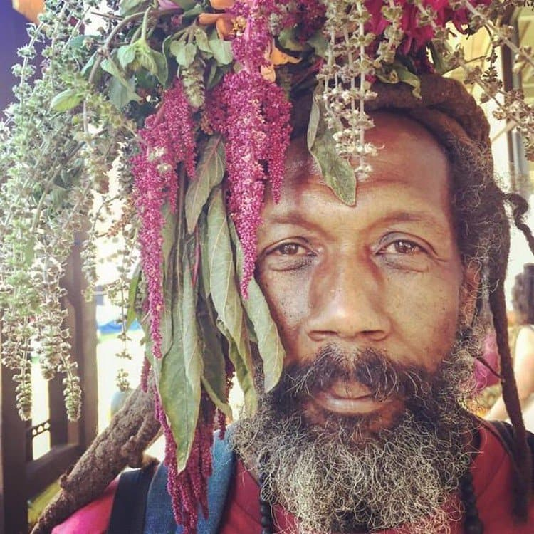 bearded man flowers on head