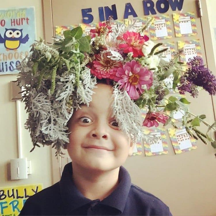 boy flowers on head