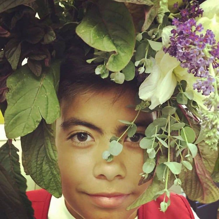 child flowers on head