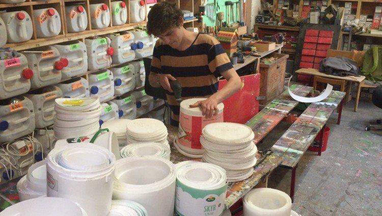 man cutting buckets
