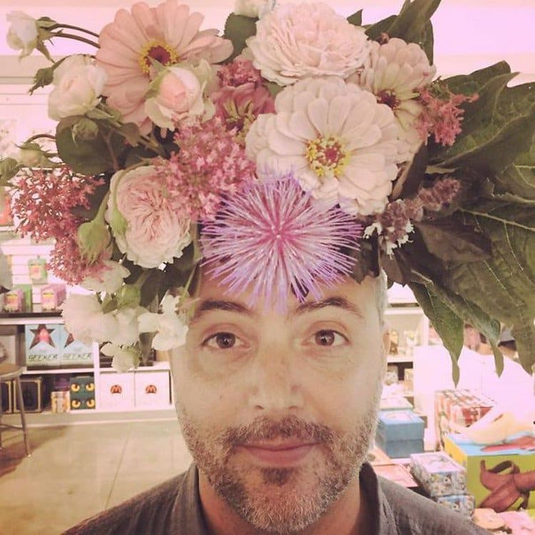 man flowers on head