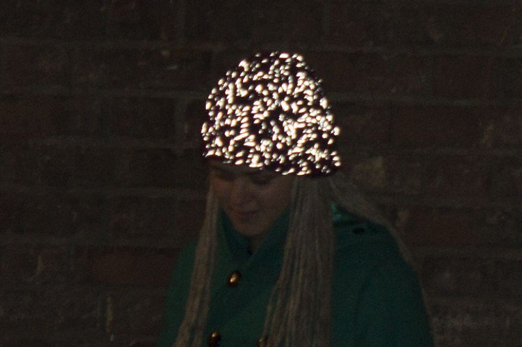 woman hat glowing