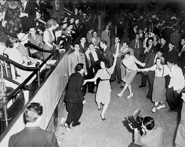 black and white photo of adults dancing at a gathering