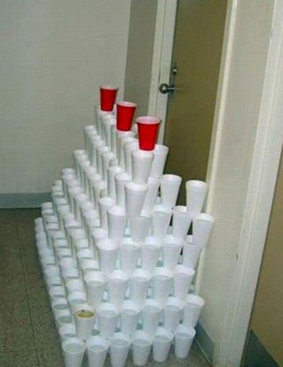 cup tower filled with liquid blocking door way