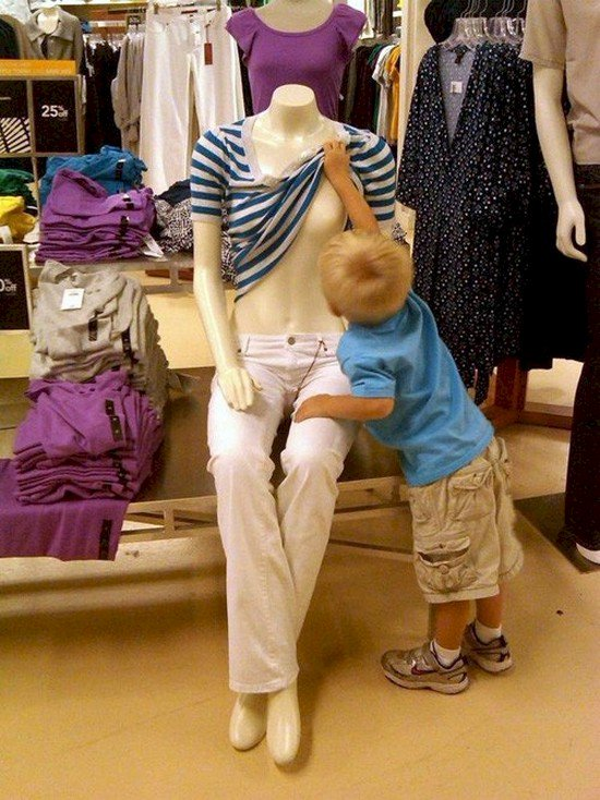 kid lifting mannequin top