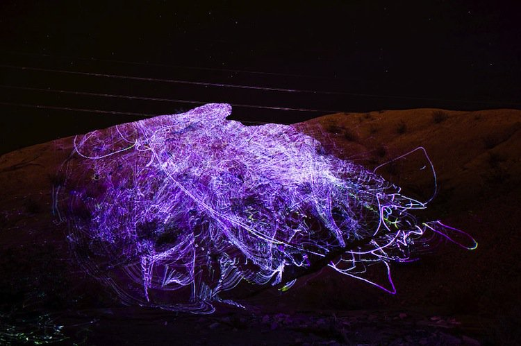 This Awesome Laser Art Was Projected Onto Canyons In The