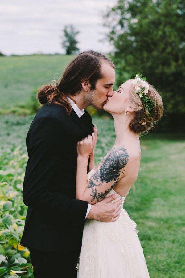 long hair man kissing bride