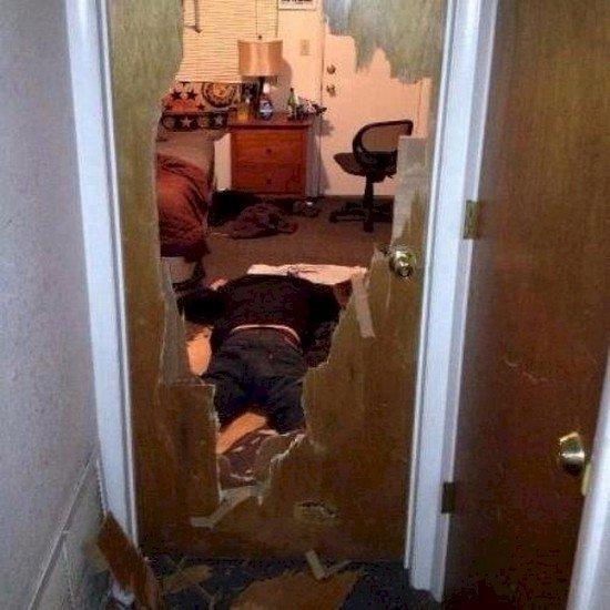 man breaks through door
