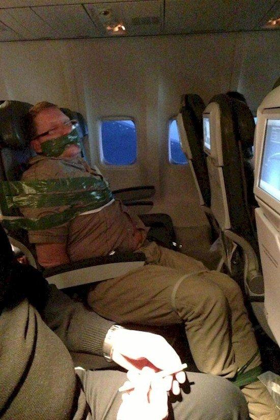 man tied up plane
