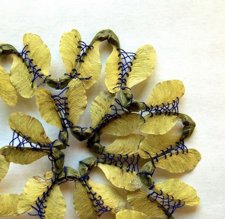 blue yellow embroidered leaf art