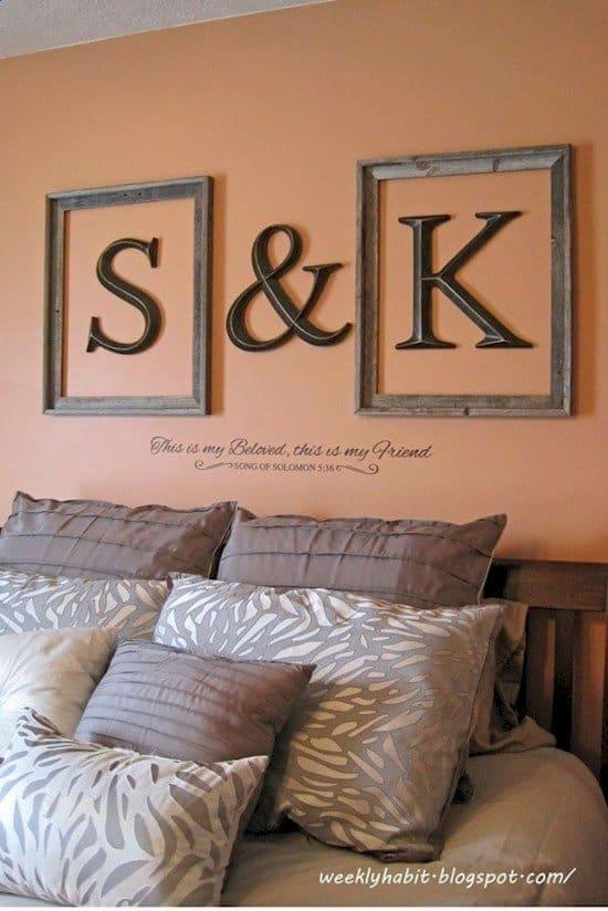 framed letters above bed