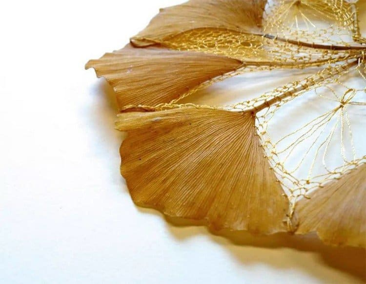 golden brown embroidered leaf art