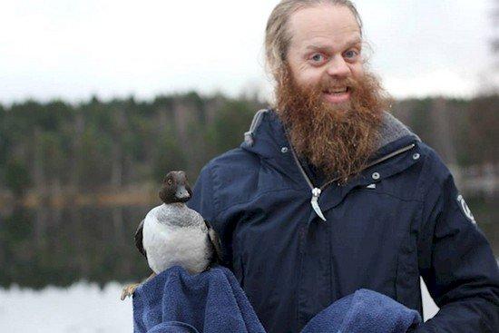 man duck towel outdoors