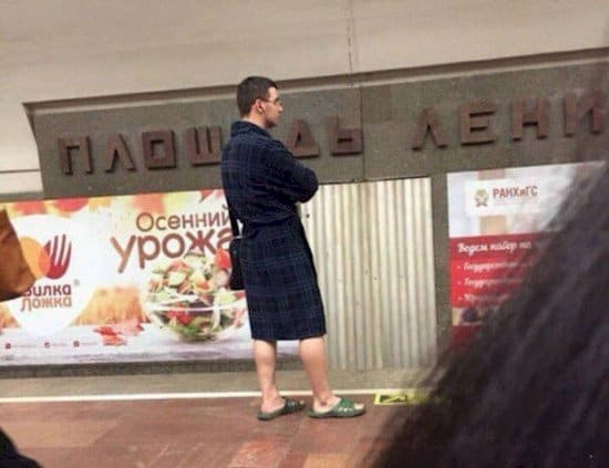 man in dressing gown outs