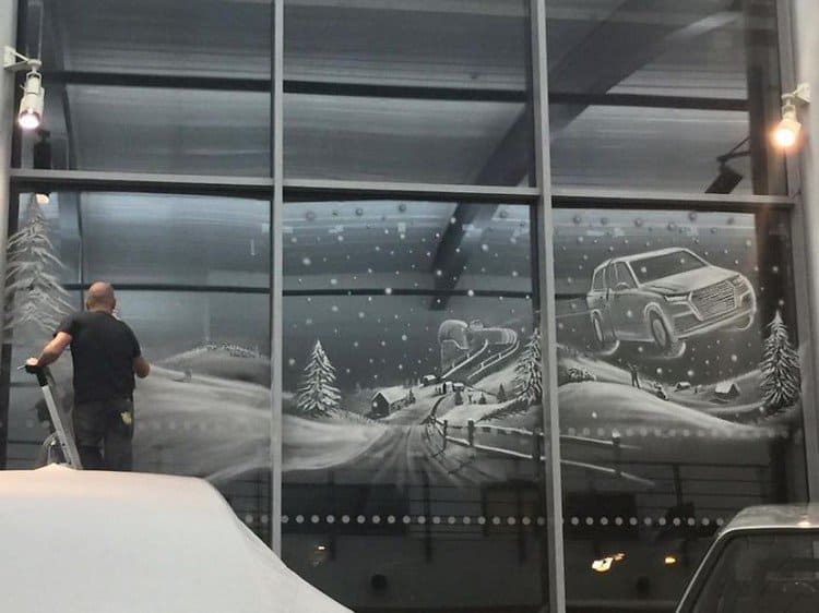 man working on car snow art
