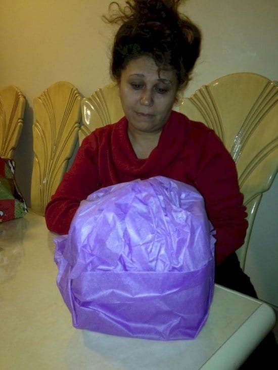 woman badly wrapped present