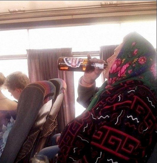 woman drinking on bus