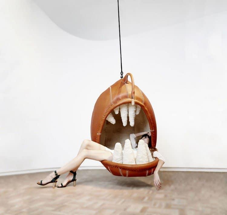 woman hanging chair teeth