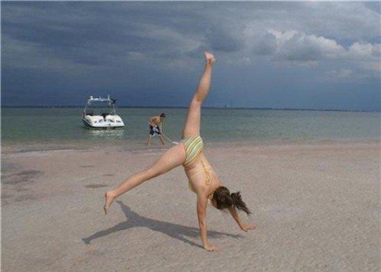 cartwheel beach woman