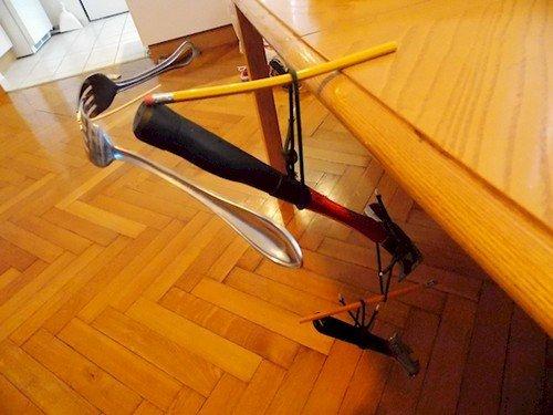 cutlery hammer junk sculpture