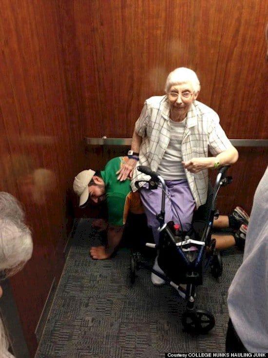 elderly woman sits on man